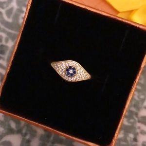 Trendy in style evil eye ring